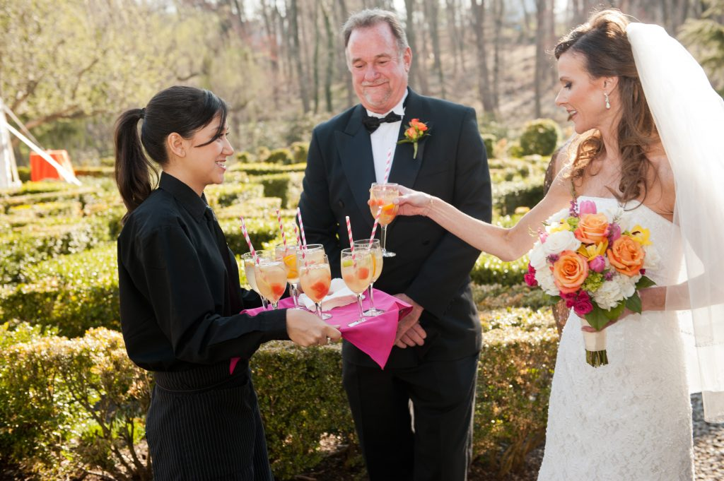 Custom Catering Services | Philadelphia and the Main Line | Bride and Father of the Bride being served drinks